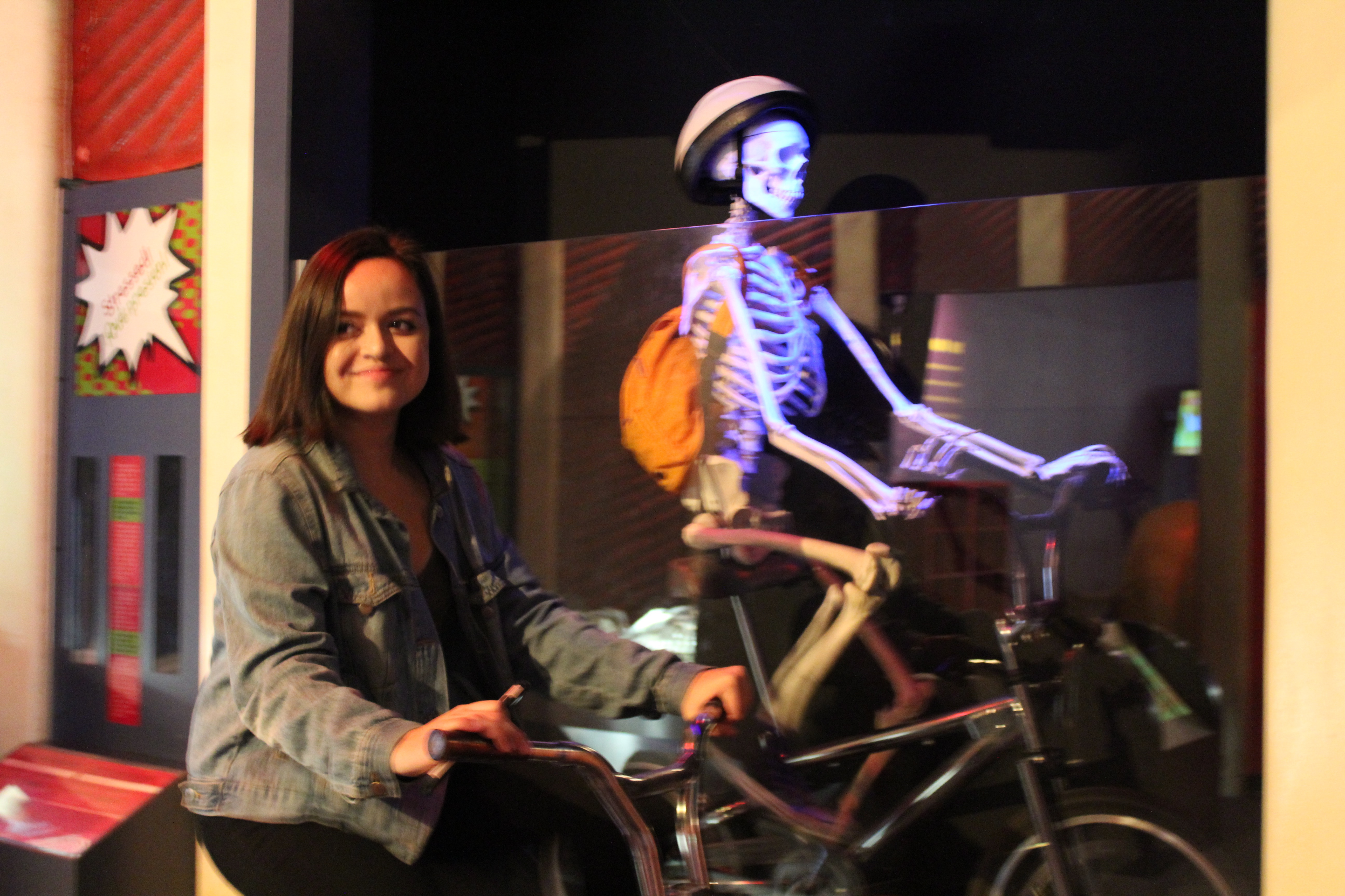 Katie Lugo exercises with her new friend at The Health Museum.