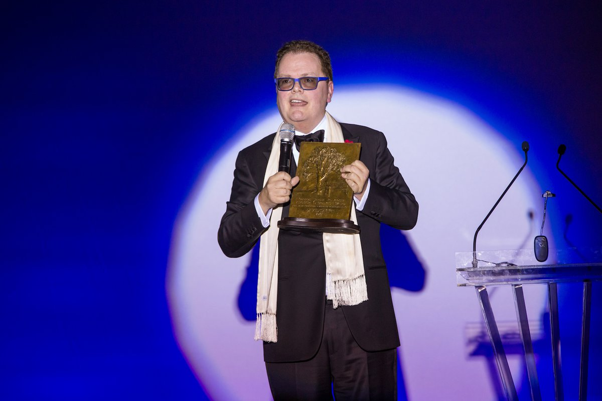 David Saint, celebrating his 20th season as George Street Playhouse Artistic Director, accepts the Arthur Laurents Award for Distinguished Artistic Achievement at GSP's Annual Gala Benefit at The Heldrich Hotel, April 2, 2017. (Photo by David Kelly Crow)